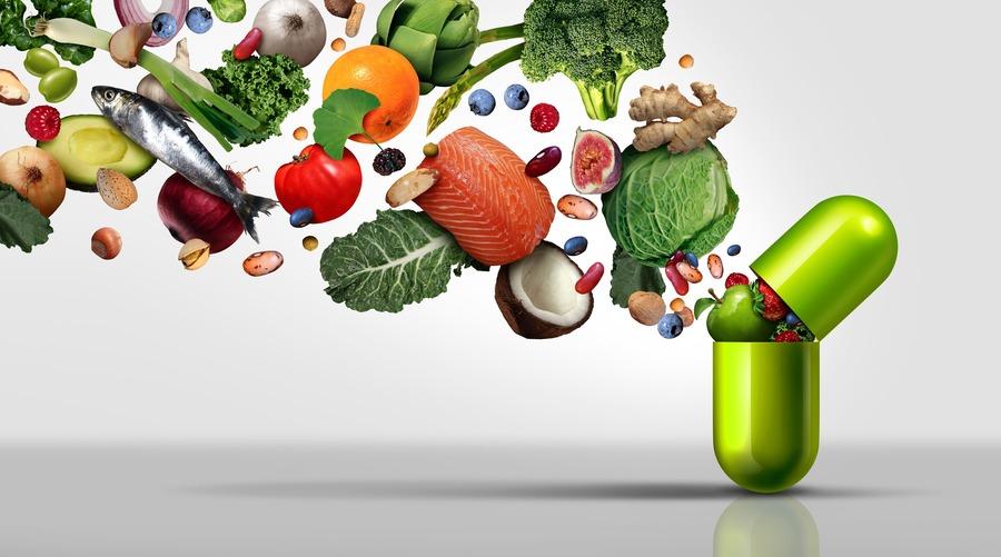 capsula verde piena di verdura, frutta e pesce